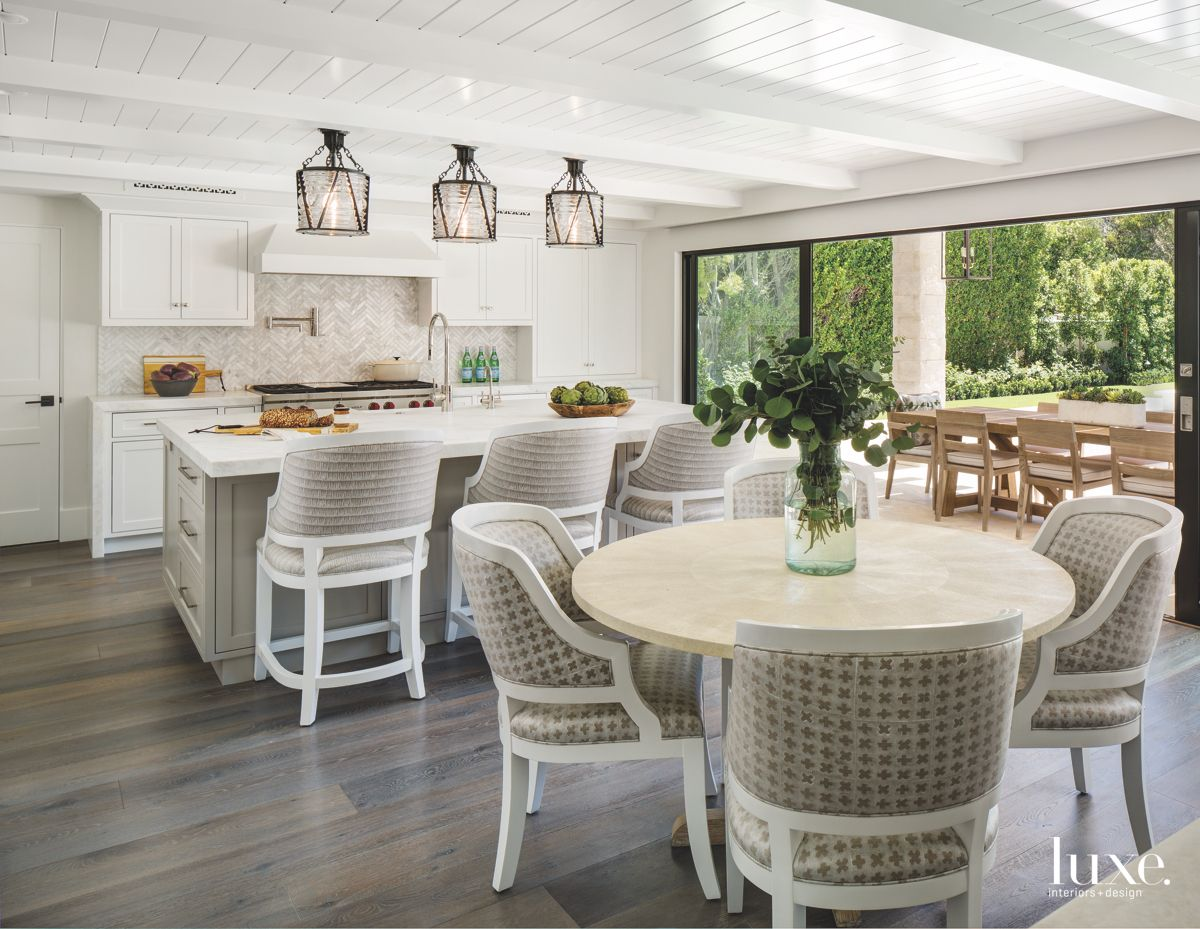Open Flow Kitchen and Dining Table with White Siding Ceiling with Herringbone Backsplash