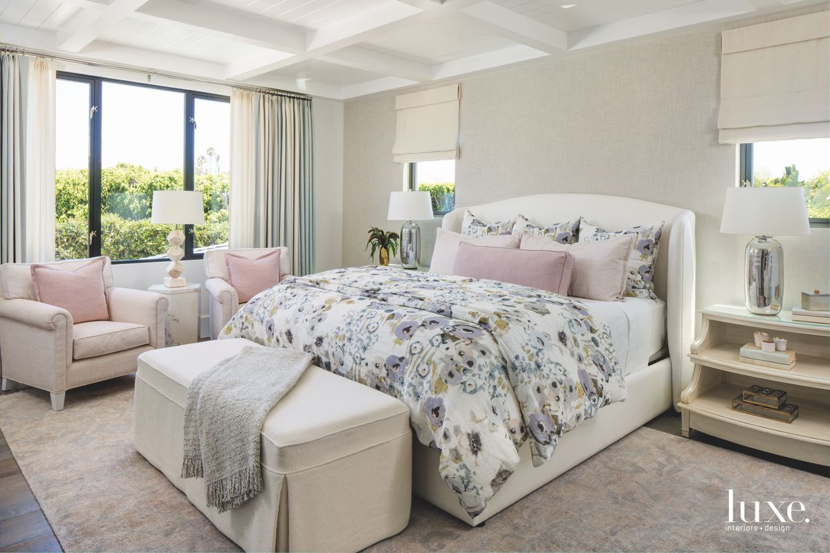 Coffered Ceiling Bedroom with Pink Pillows and Patterned Comforter