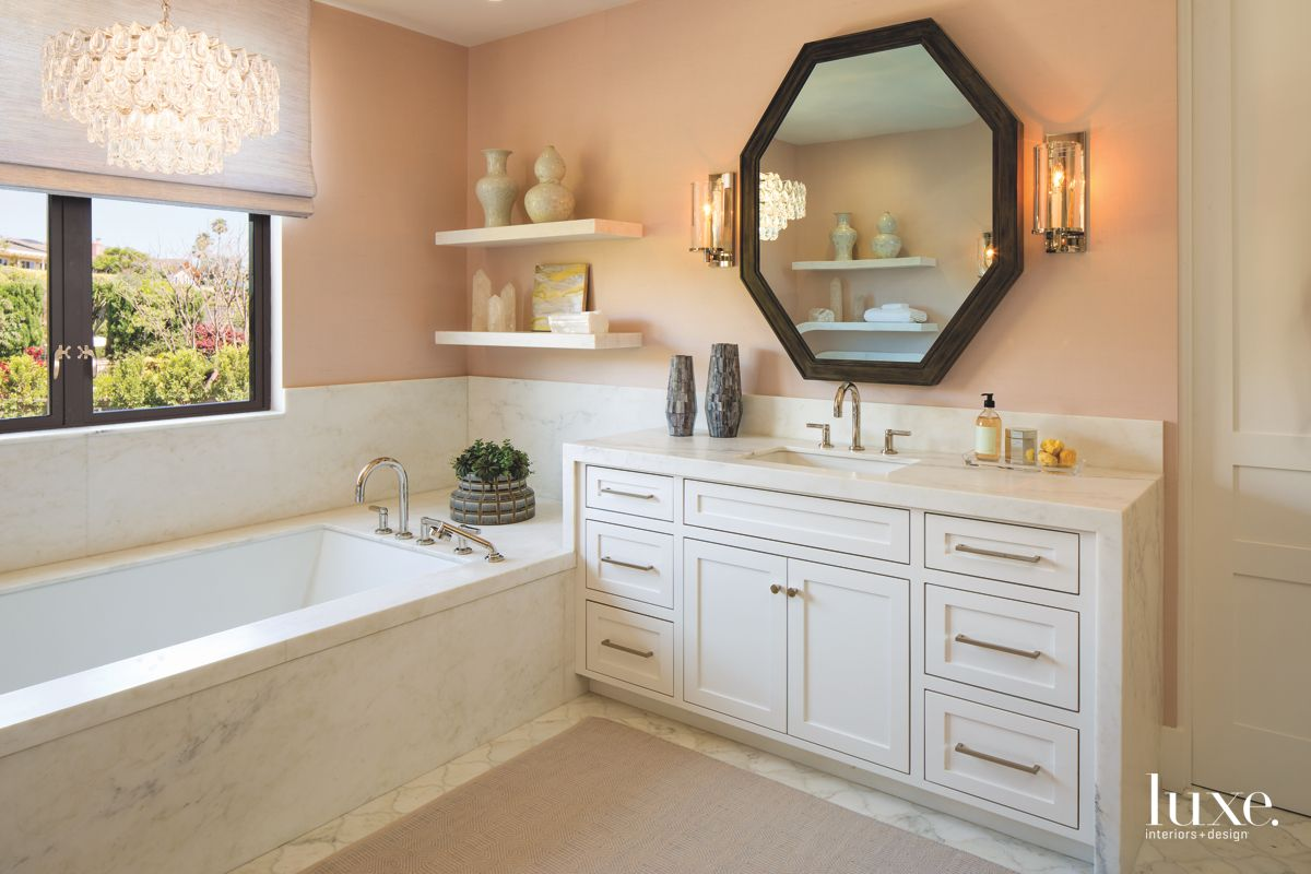 Peach Master Bathroom with Octogonal Mirror and Sleek Hardware