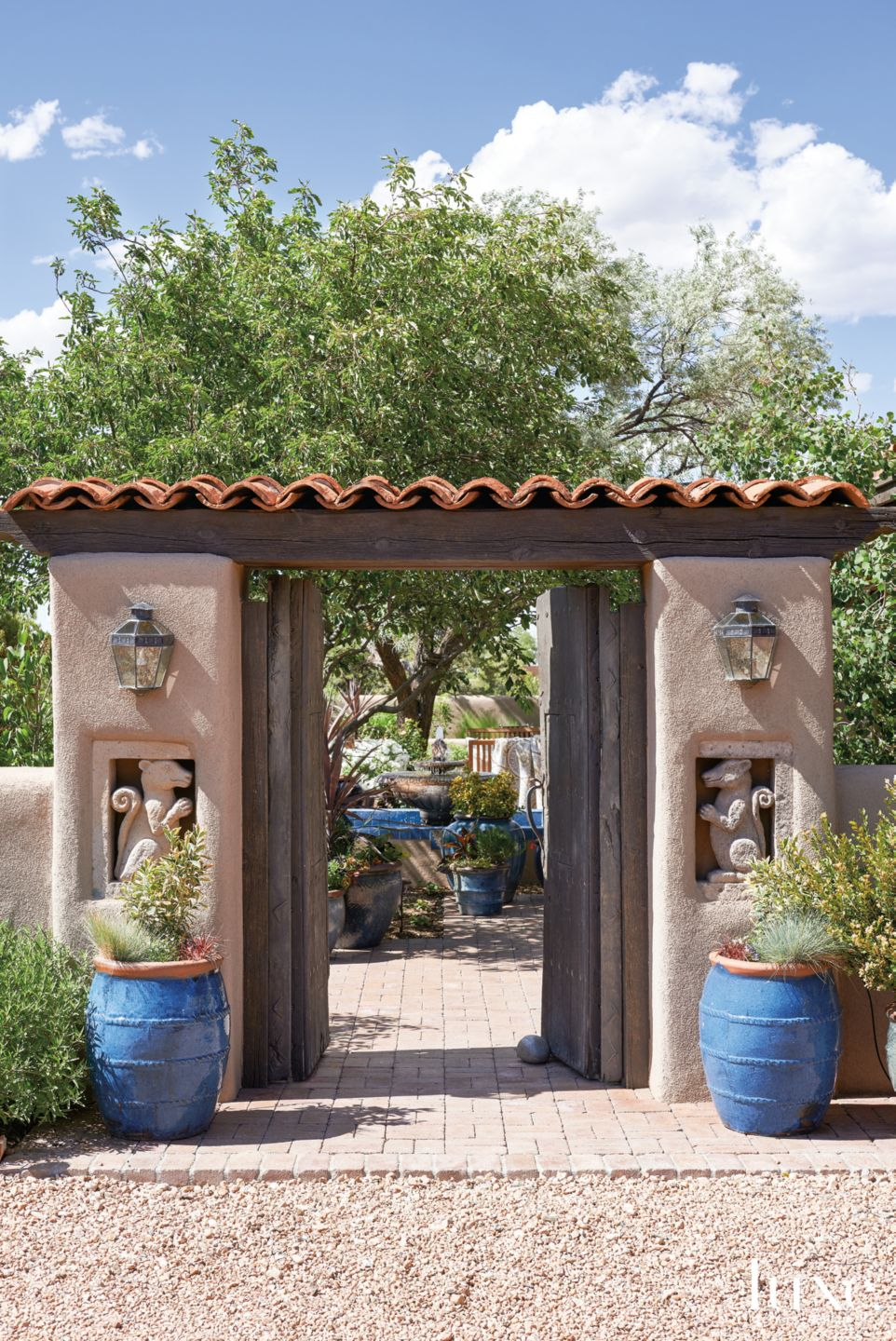 Mediterranean Neutral Outdoor Entry with Original Antique Doors