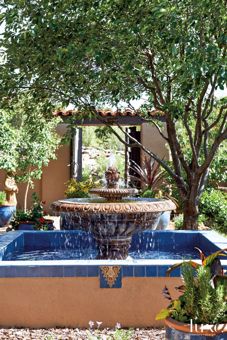 Mediterranean Neutral Fountain with Blue Tile