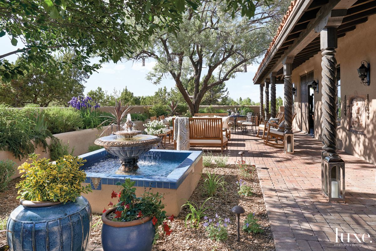 Mediterranean Neutral Courtyard with Adobe Walls