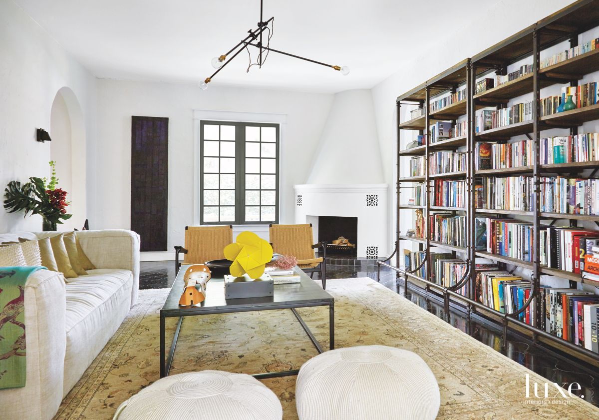 White Old World Chimney with Bookshelf Library and Sofa