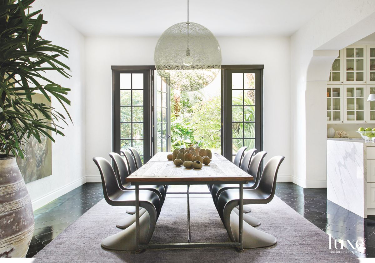 Sleek Gray Chair Dining Room with Chandelier
