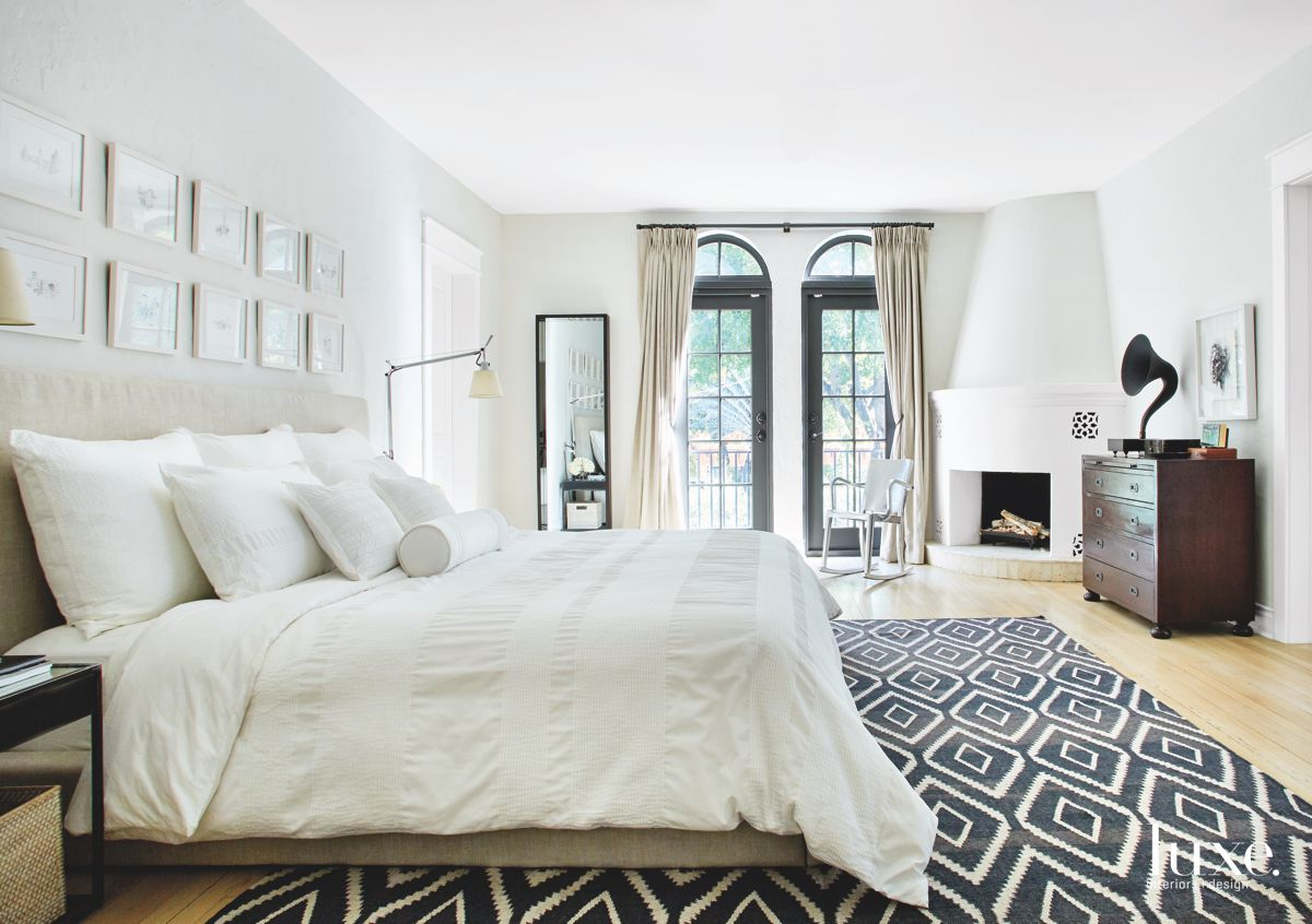 All White Master Bedroom with Patterned Rug and Owner's Sketches
