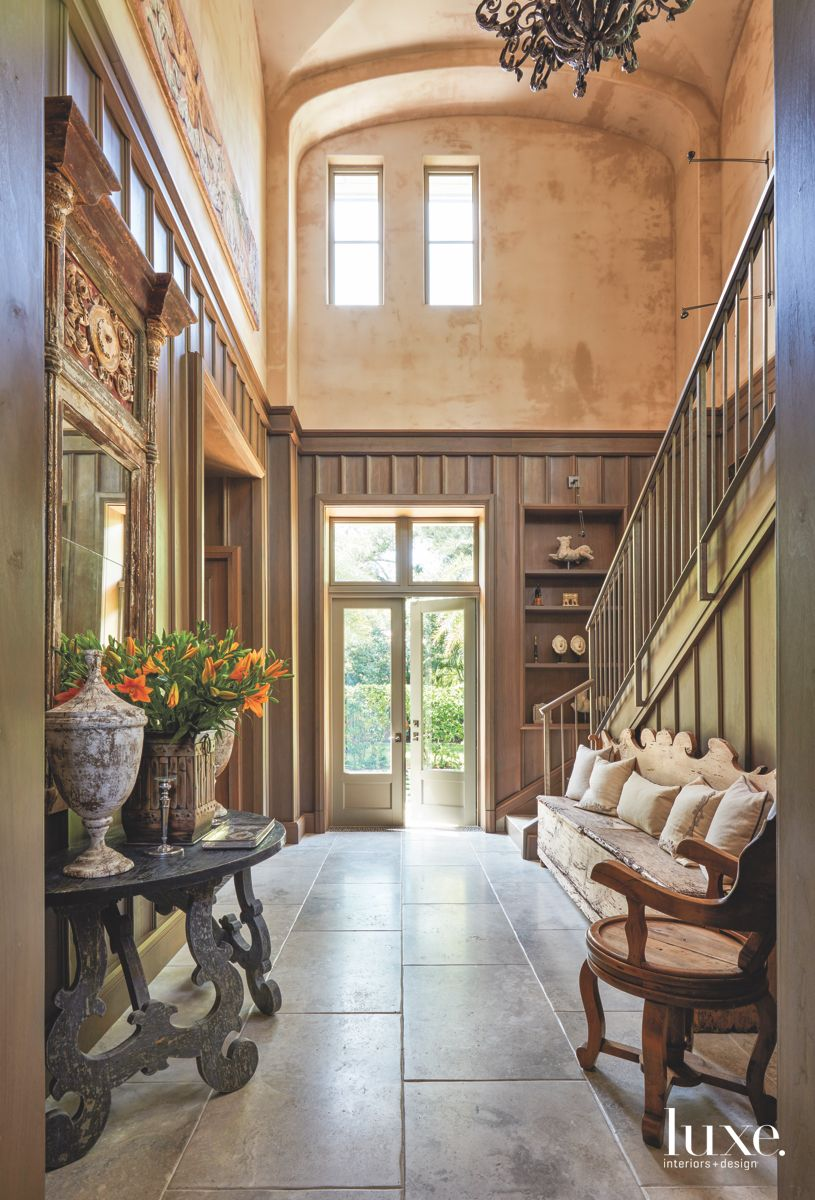 Dramatic Statement Entry Hall with Custom French Doors