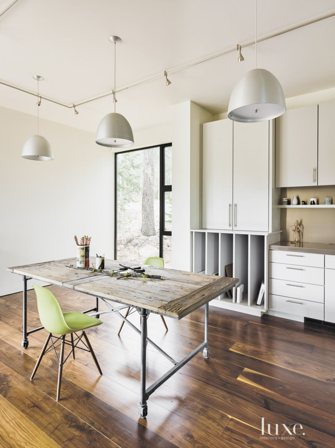 Contemporary Neutral Art Studio with Green Chairs