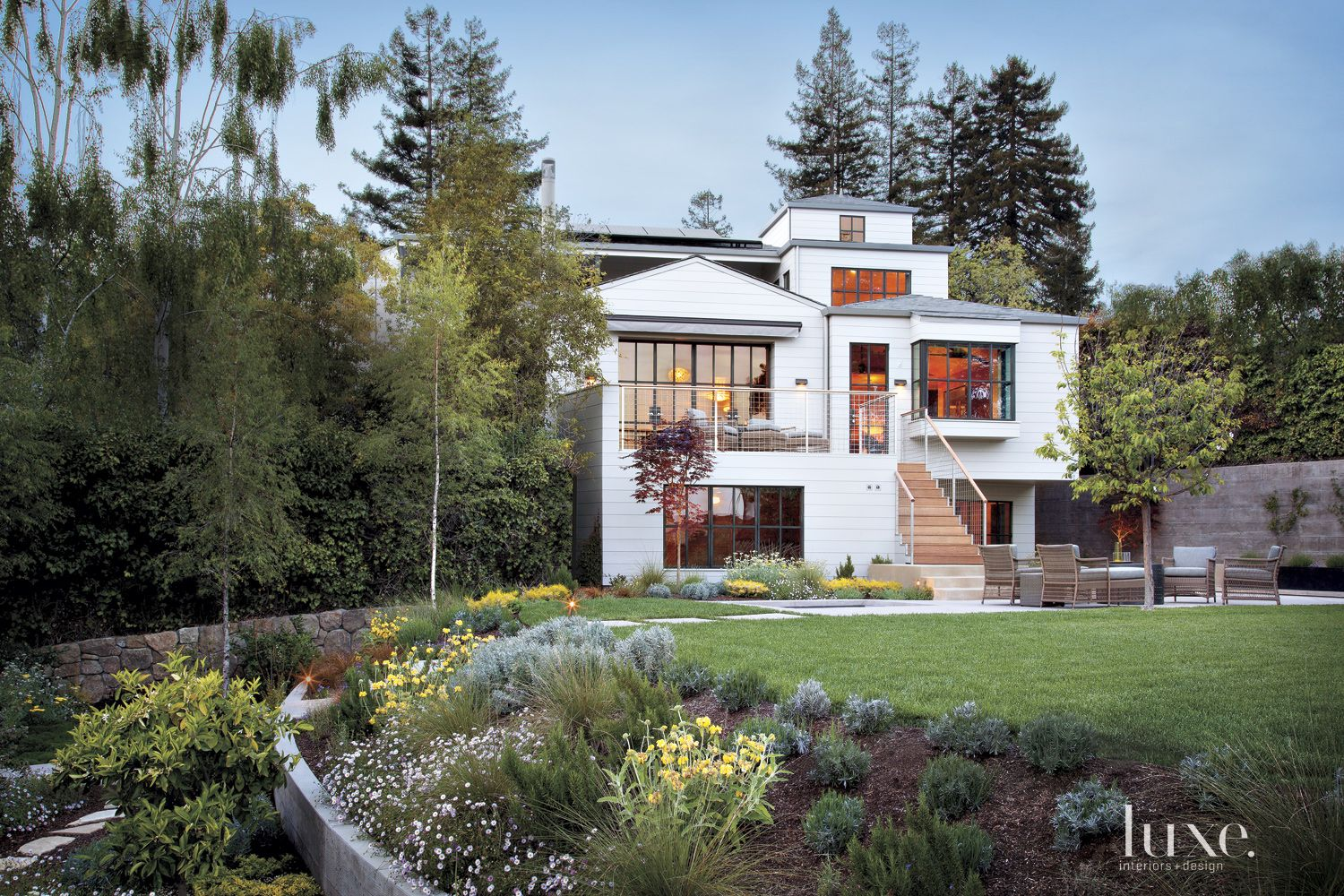 Contemporary White Exterior with Verdant Landscape
