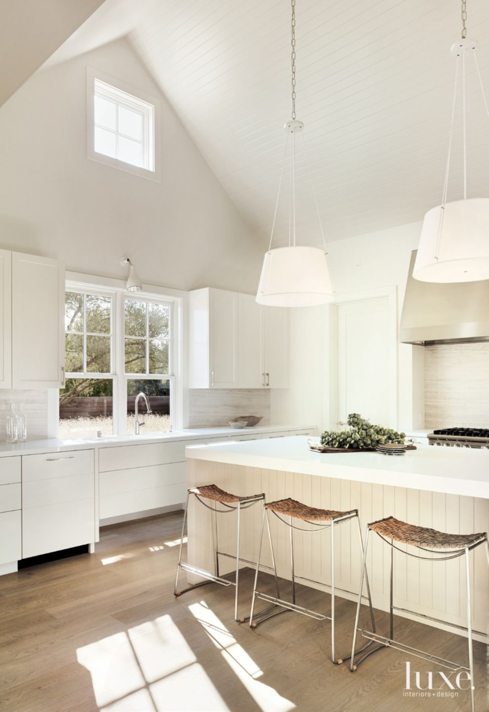 Contemporary White Kitchen with Vaulted Ceiling