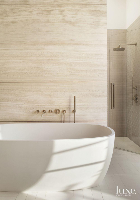 Modern Limestone Master Bath with Soaking Tub