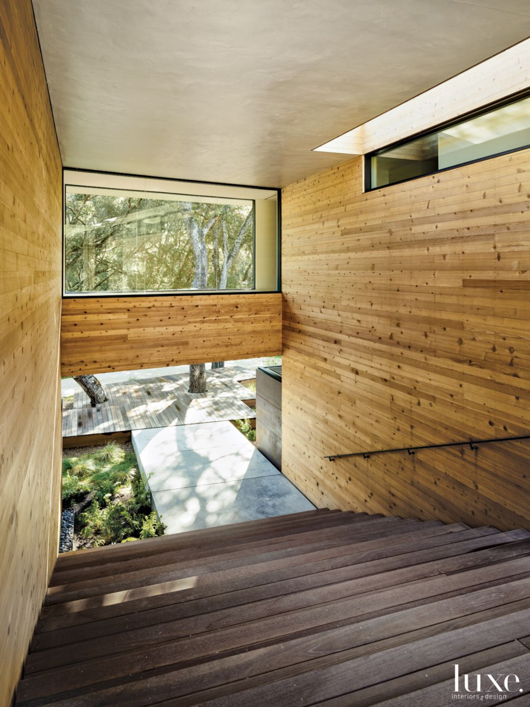 Modern Neutral Entry Stairway with Cedar Siding
