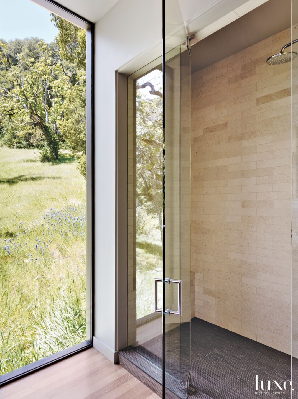 Modern Neutral Bathroom with Floor-to-Ceiling Window