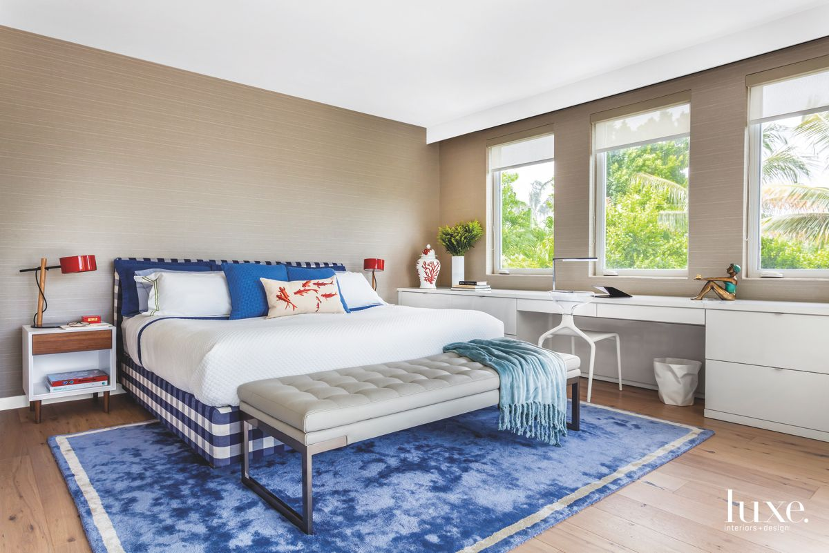 Gray Linen Wallcovering Master Bedroom with Blue Rug and Pillow Accents