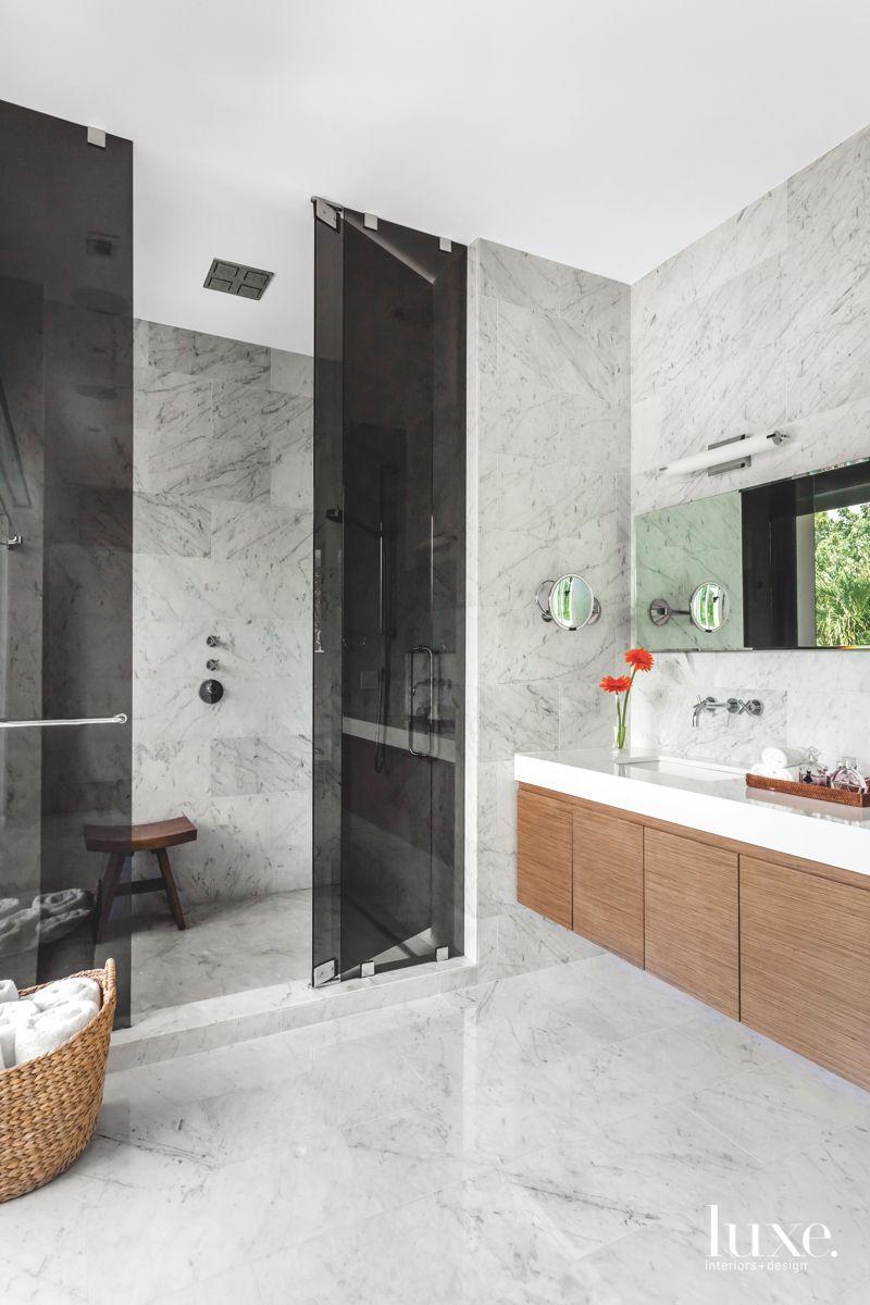 Minimalist Carrara Marble Master Bathroom with Wooden Floating Vanity