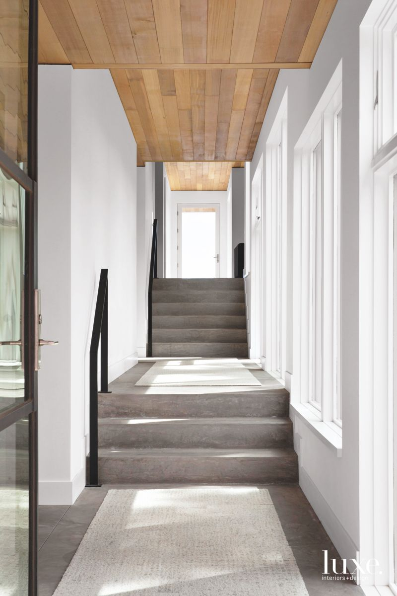 Long Hallway with Railing, Concrete and Wood