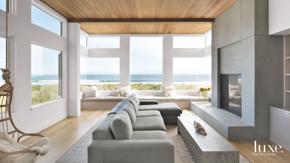 Gray and White Living Room with Concrete Fireplace and Views