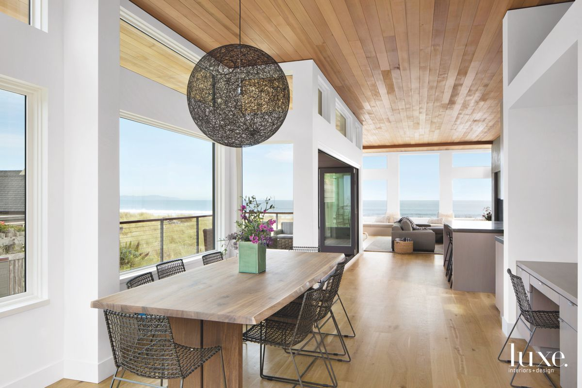 Pendant Dining Room with Wooden Table and View