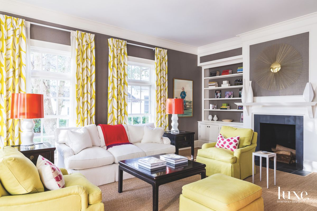 Moody and Bright Chartreuse Living Room with Fireplace and Burst Chandelier