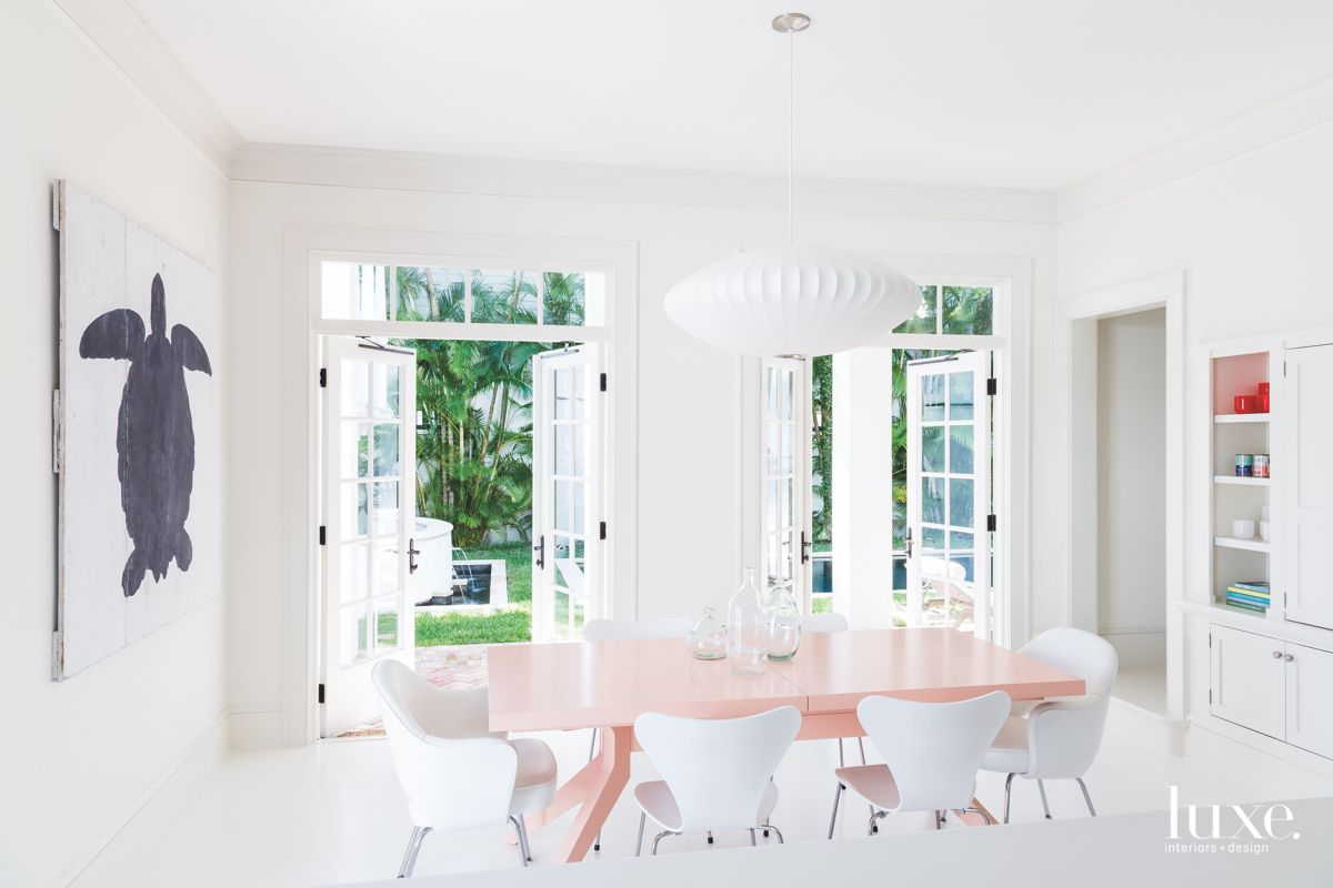 Turtle Art Dining Room with Blush Pink Table and Iconic Lighting Pendant