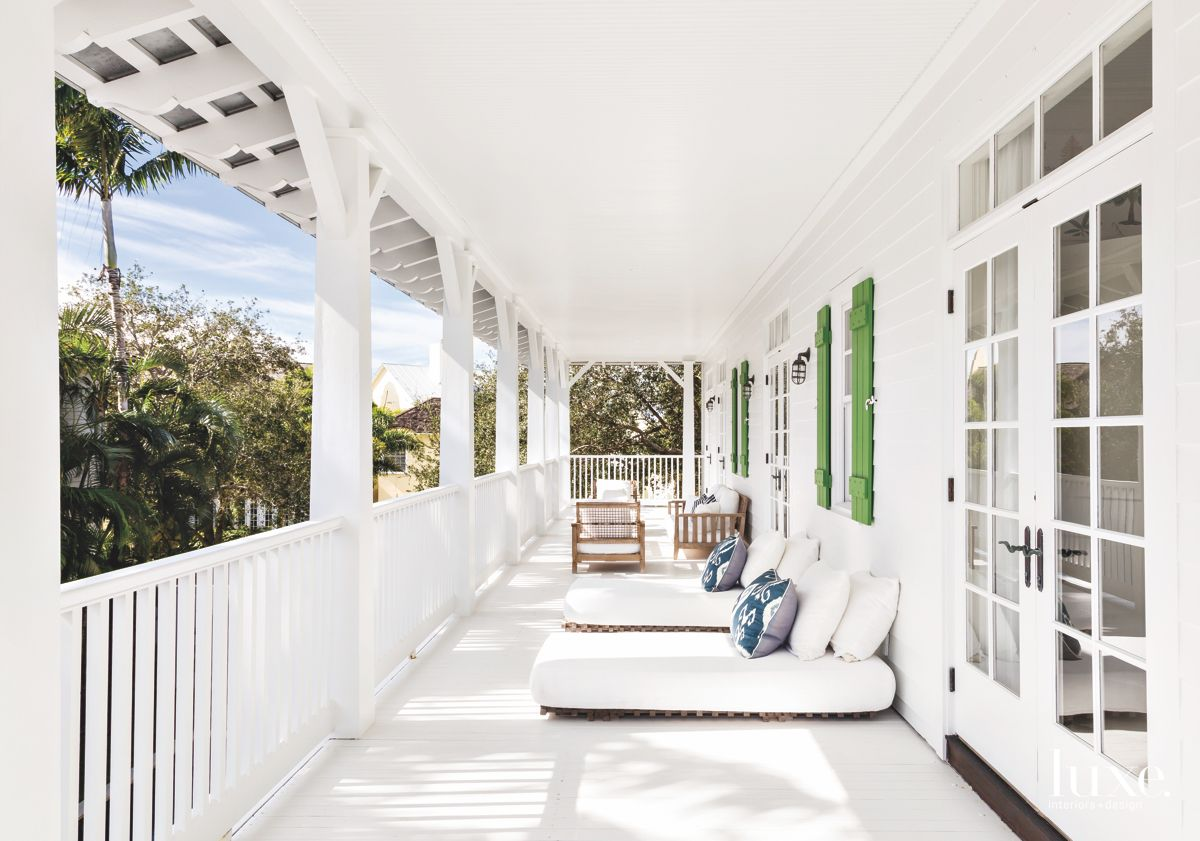 White Porch with Comfortable Lounge Furniture and Green Shutters