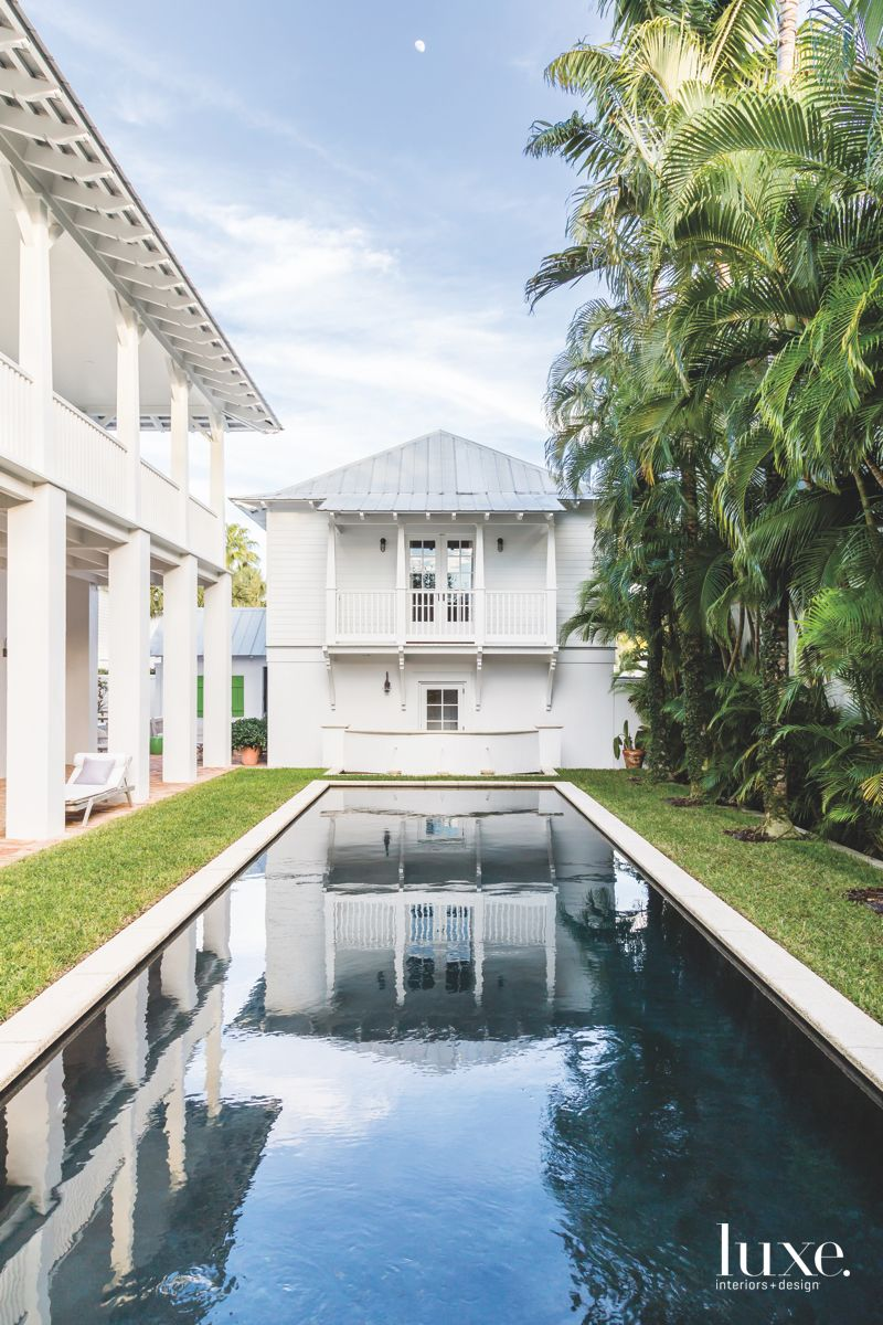 Moody Dark Pool with Palm Tree Fence Lining