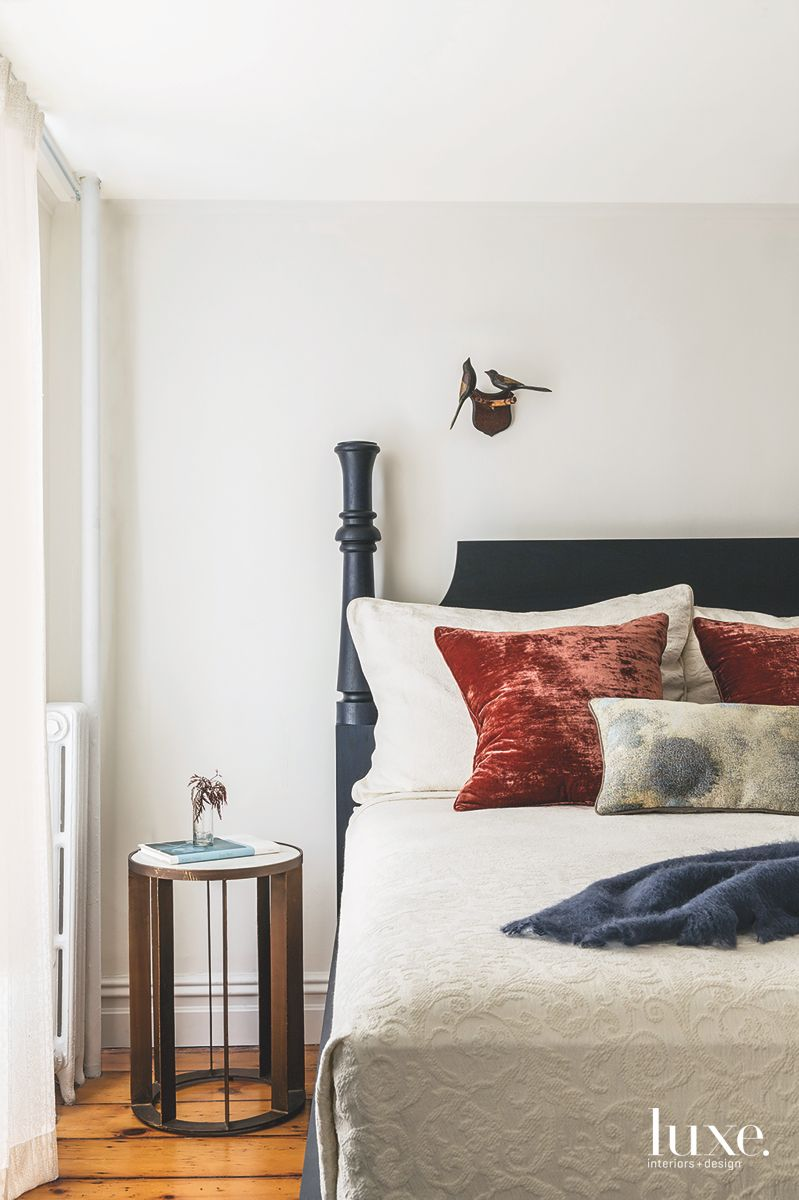Off White Neutral Master Bedroom with Accent Pillows and Bird Art