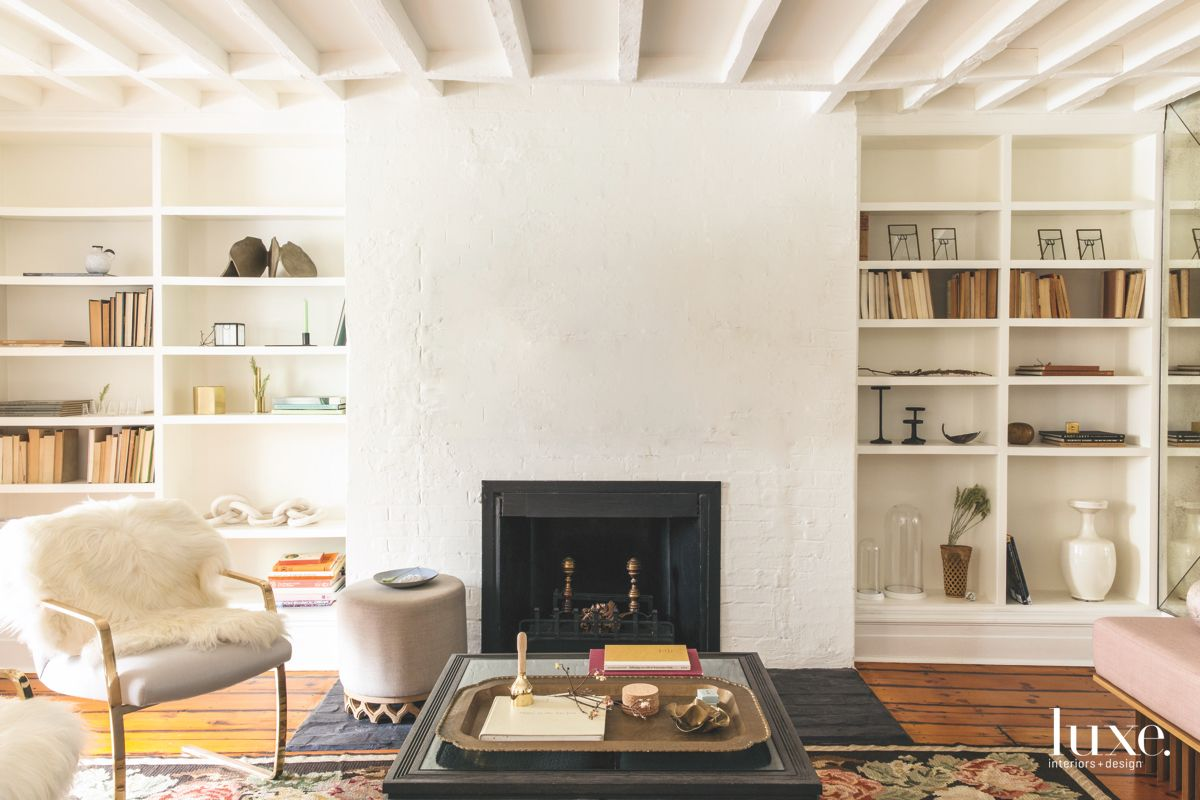 Fluffy Chair Living Room with Fireplace, Coffered Ceiling, and Shelving