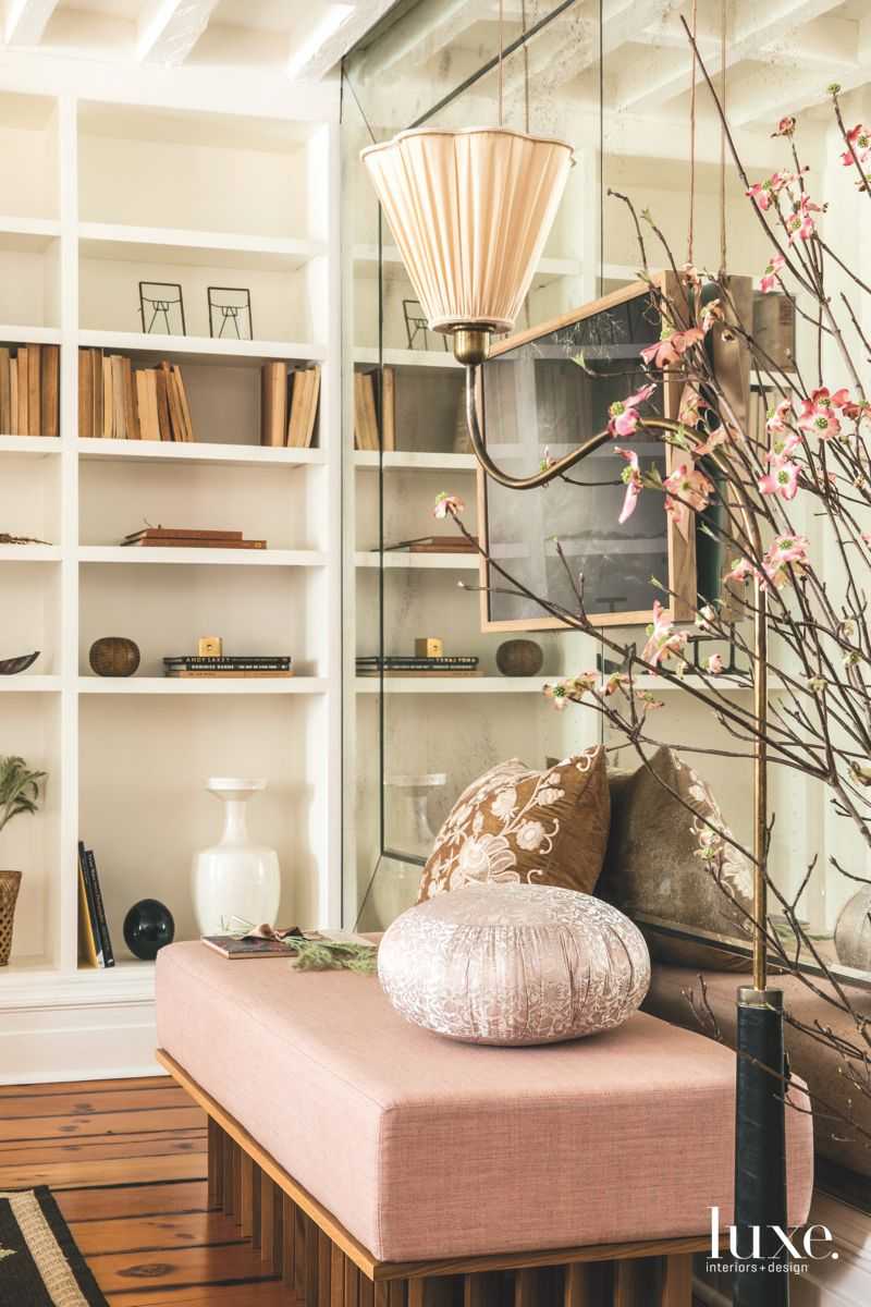 Mirrored Wall with Pink Accents Bench and Shelving