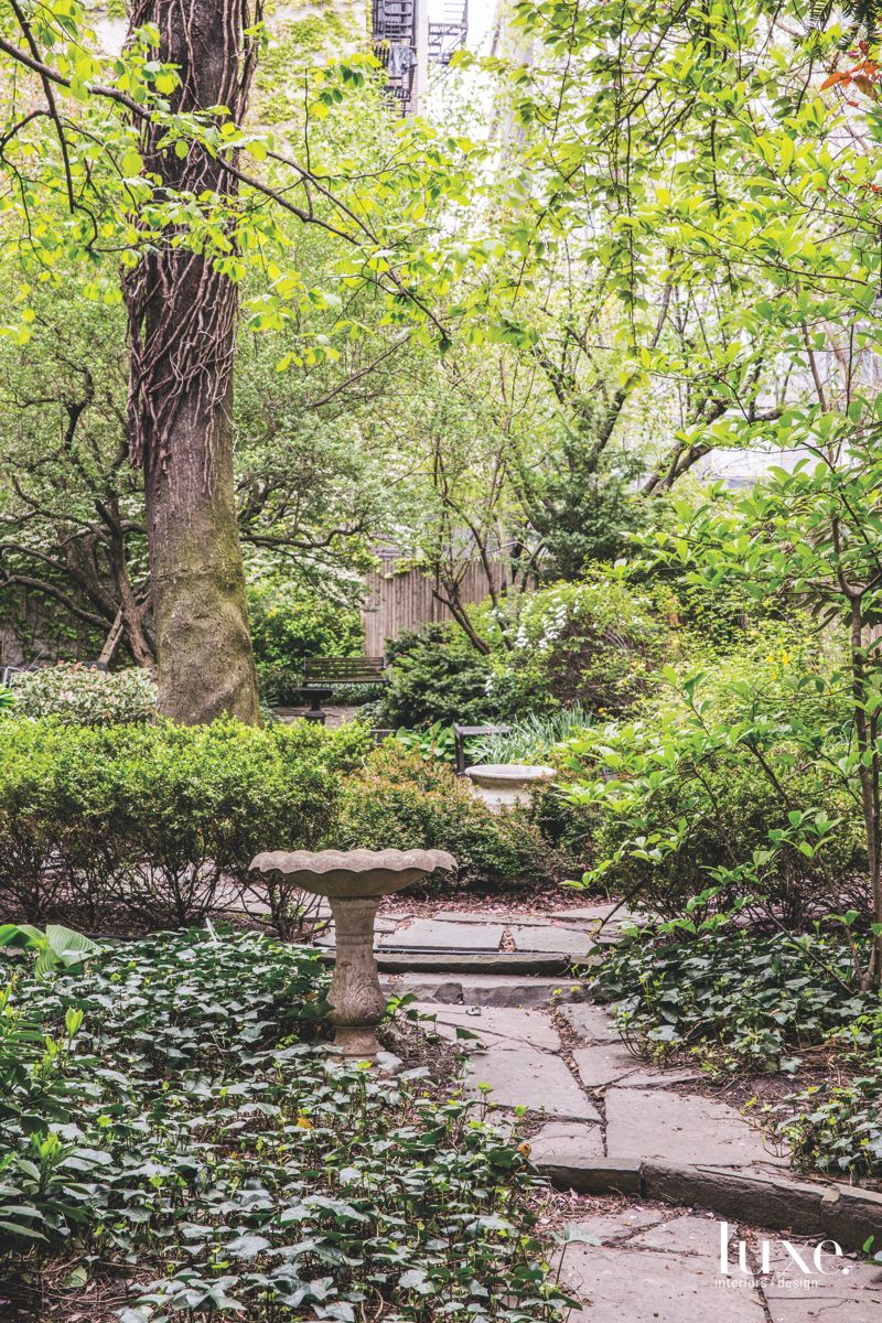 Green Lush Manhattan Courtyard with Old Growth Vines and Ceramic Pieces