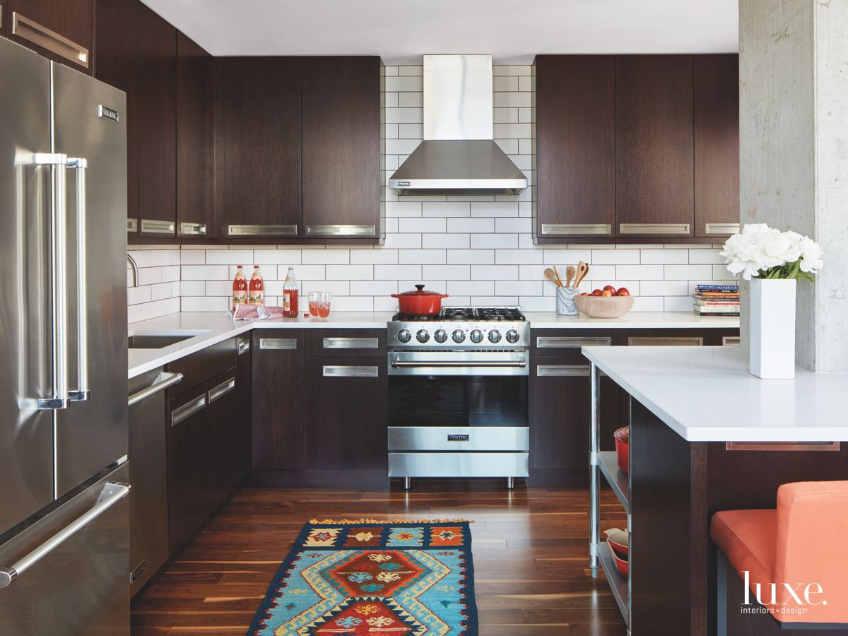 Kitchen with Pure White Countertops and Contrasting Dark Kitchen Cabinets