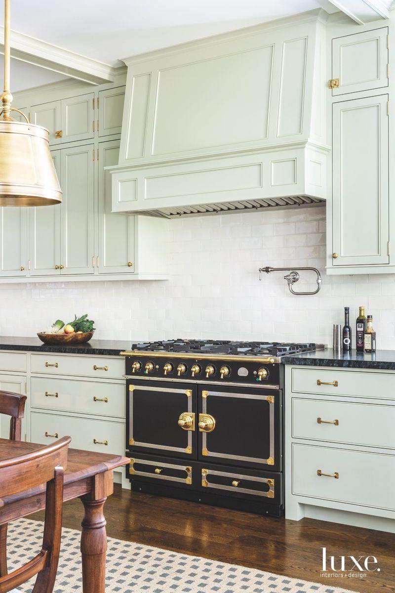 Black Kitchen Range Contrasting Light Green Cabinets