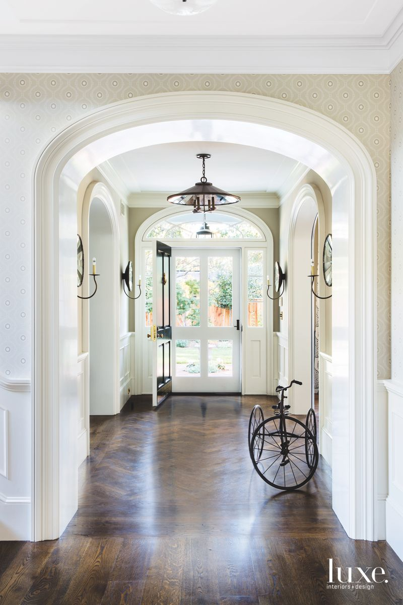Archway with Subtle Wallpaper and Vintage Tricycle