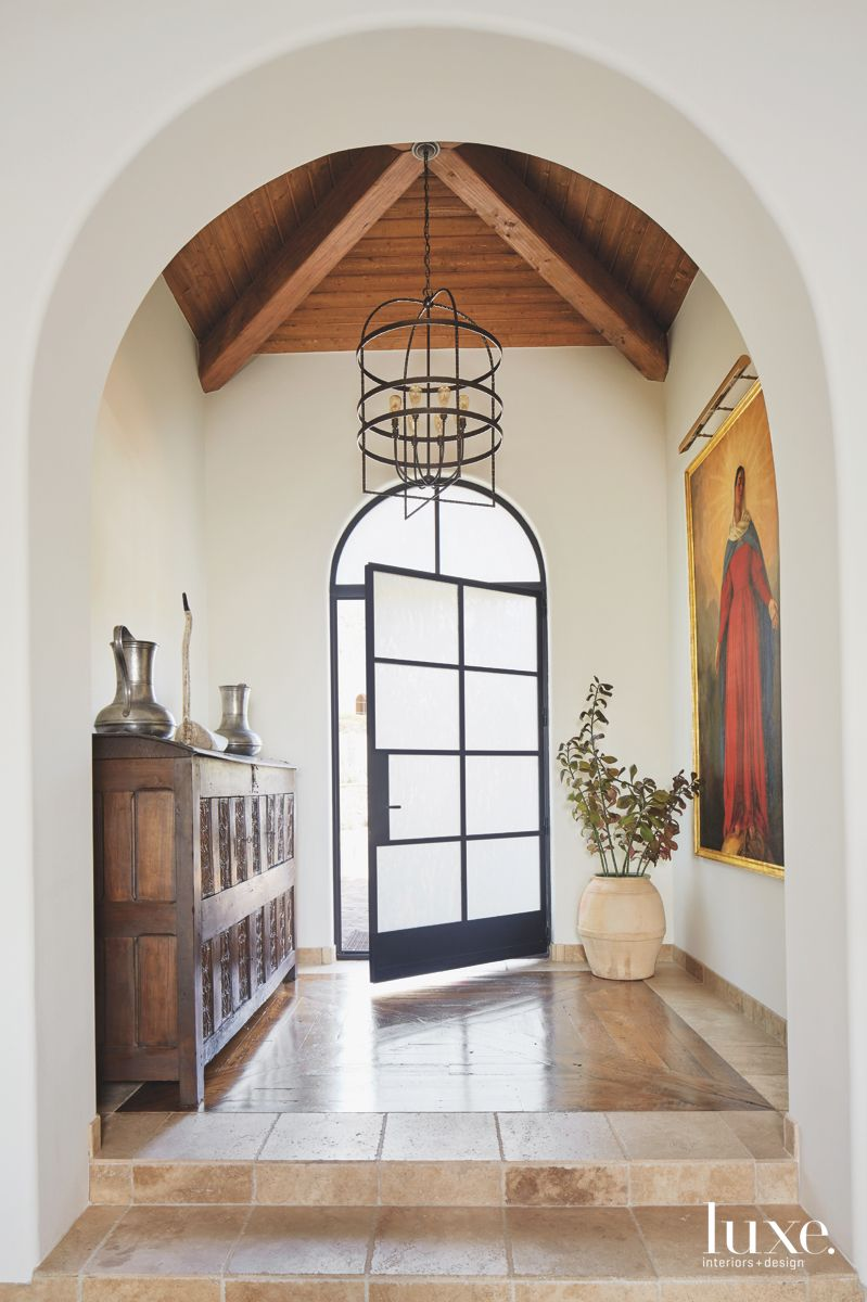 Arched Entryway with Contemporary Door, Reclaimed Wood Ceiling and Iron Chandelier