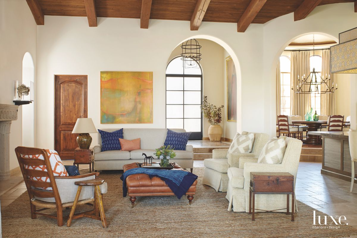 Wooden Beam Vaulted Ceiling Living Rooms with Blue Pillows Throw and Off White Chairs