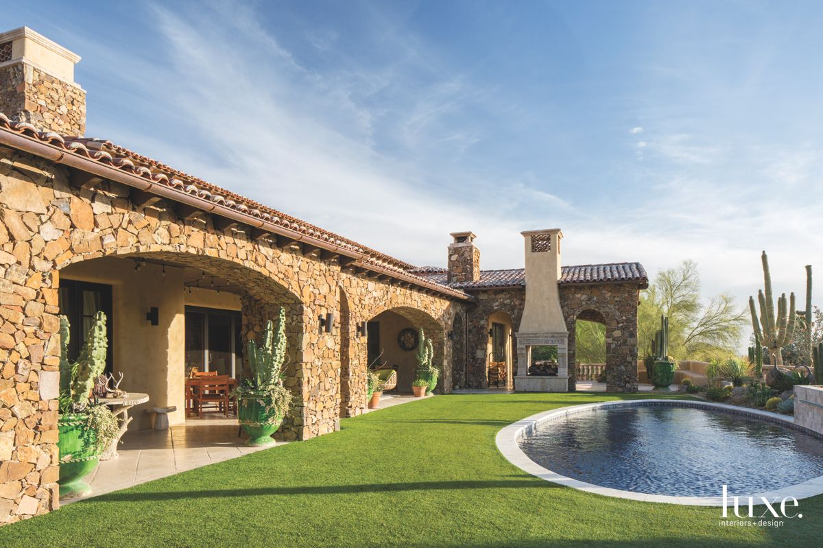 Brown Stone Exterior Loggia with Circular Pool, Fireplace and Cactus