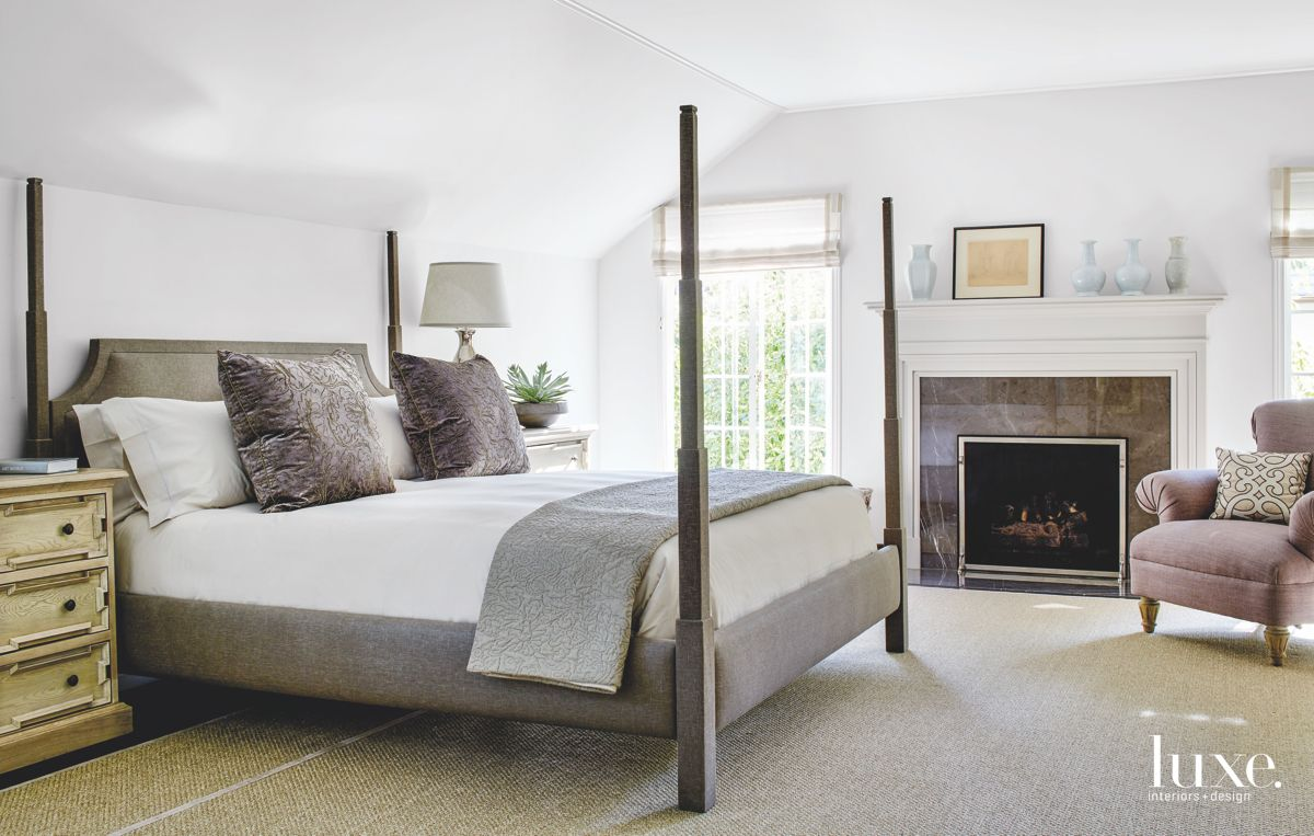 Custom Four Poster Bed White Master Bedroom with Artwork and Fireplace