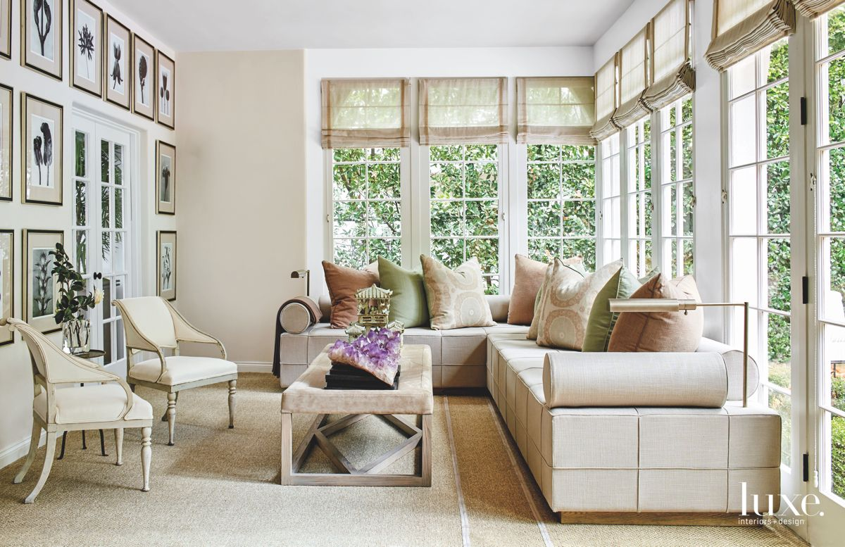 Roman Shades and Art Open Bright Sunroom