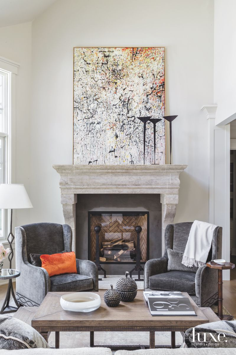 Splatter Paiting Fireplace Living Area with Gray Chairs
