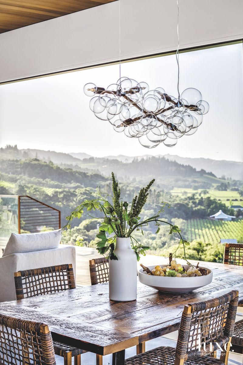 Bubble Chandelier Dining Room with Overlooking View