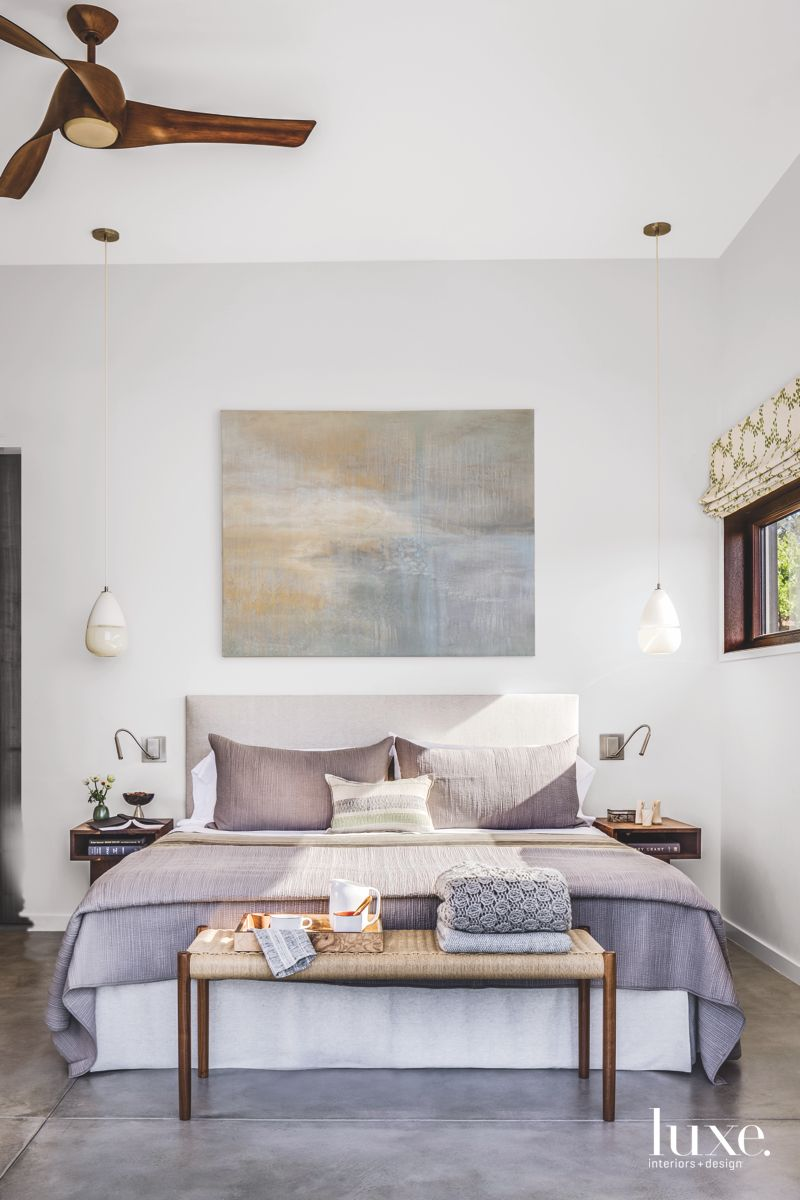 Warm Grayscale Master Bedroom with Art and Light Pendants