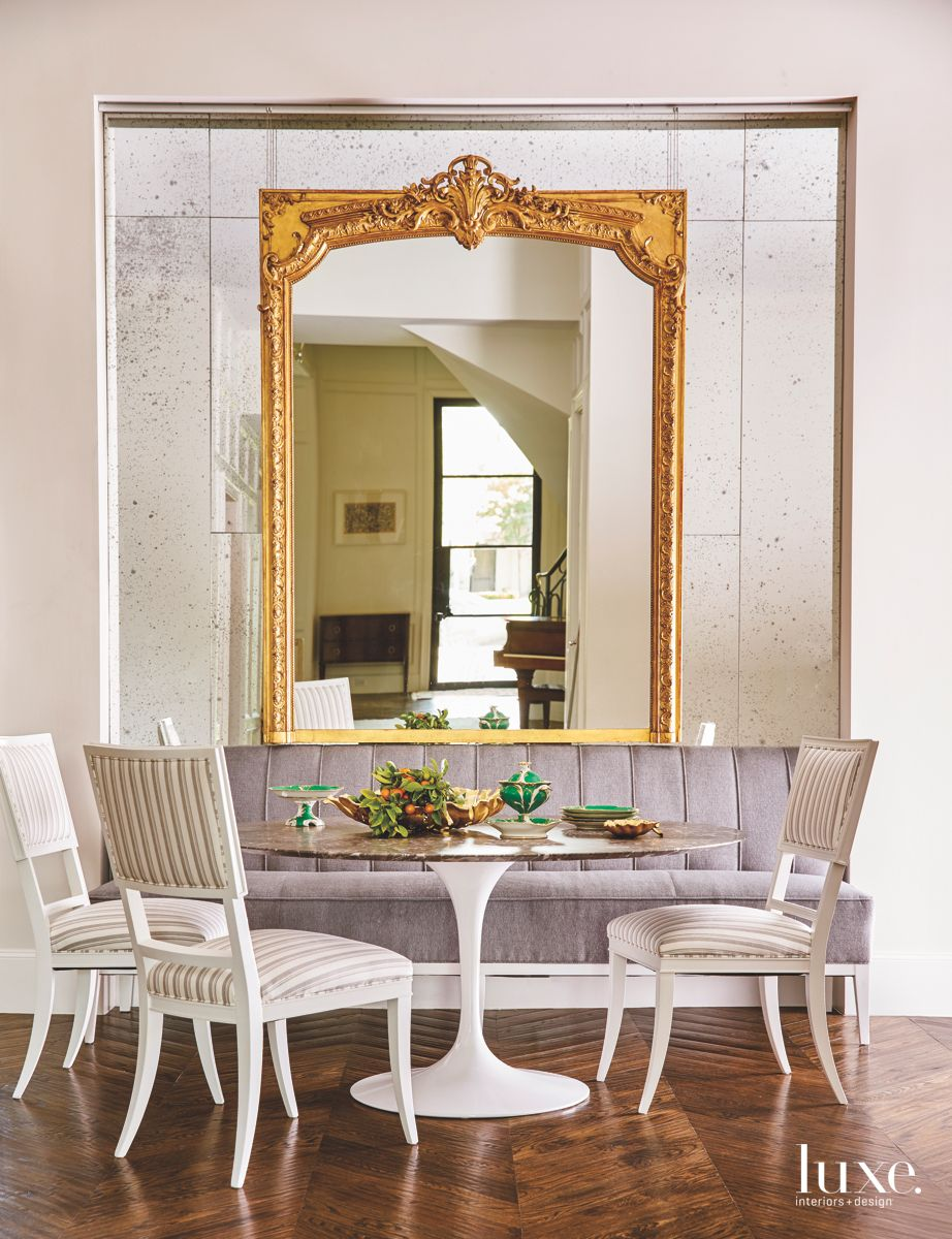 Gold Frame Breakfast Area with Mirrored Wall and Banquette