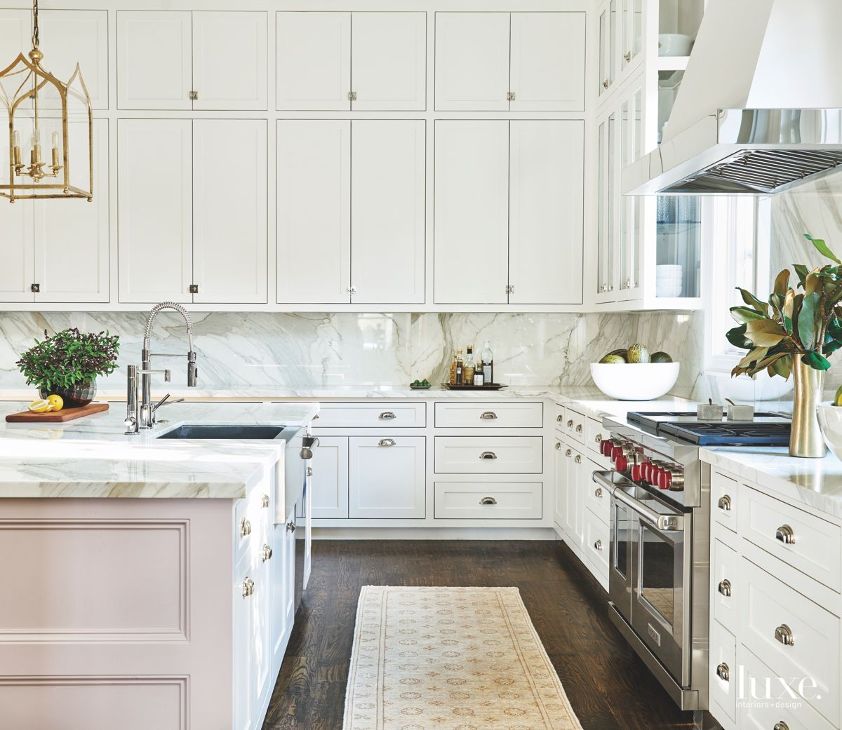 White Kitchen Cabinetry with Lantern Lighting and Runner Rug