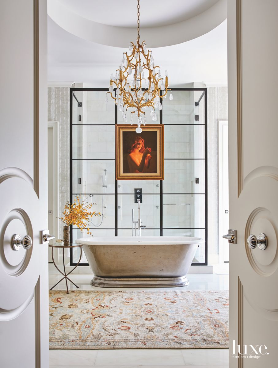 Fancy Chandelier Master Bathroom with Artwork and Dividing Wall