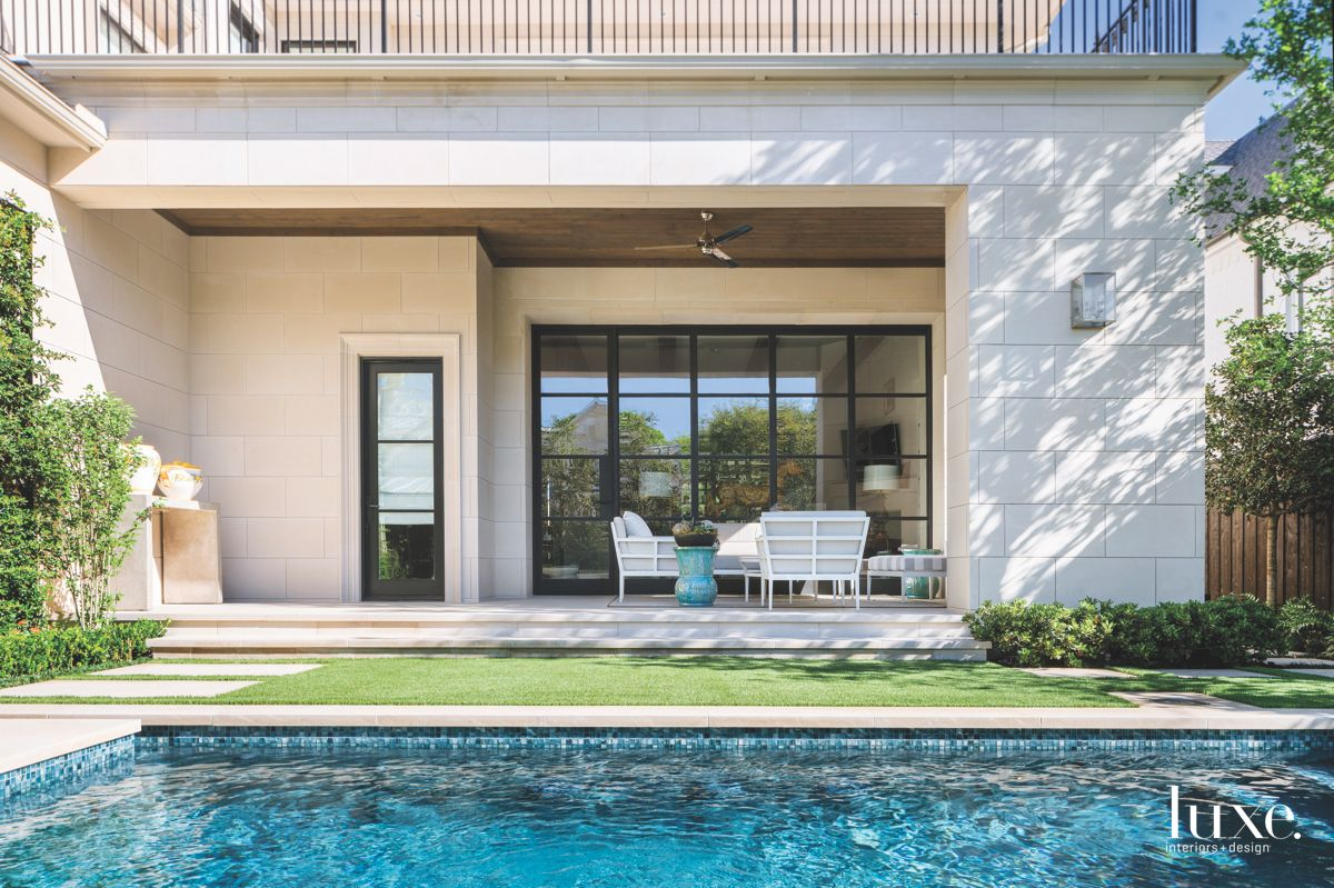 Dallas Outdoor Rectangular Pool with White Outdoor Furniture and Urns
