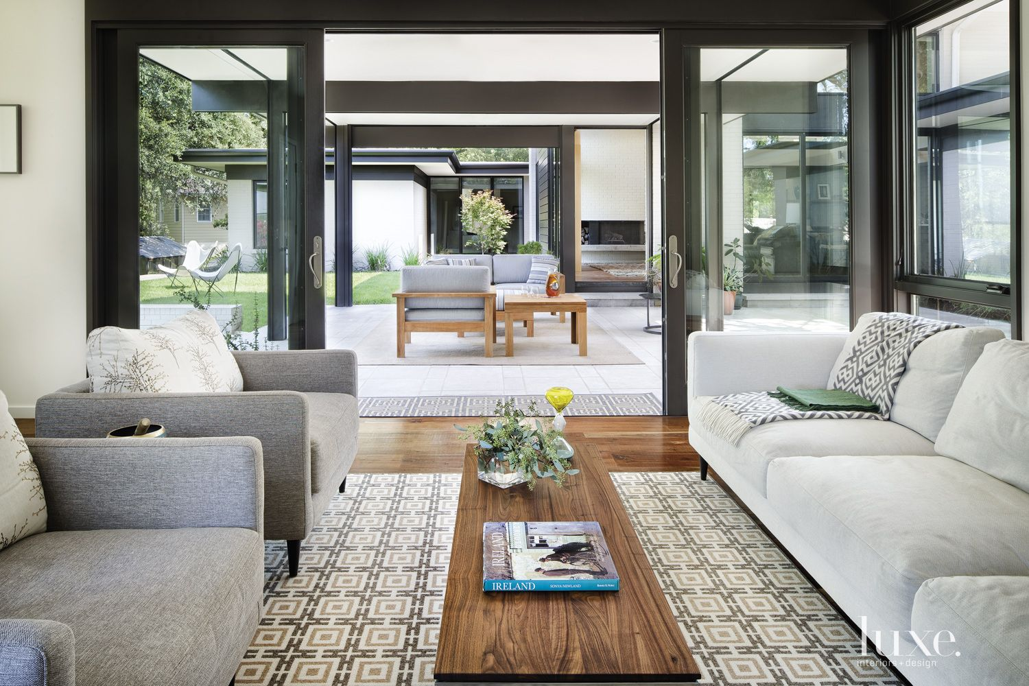Contemporary White Living Room with Sliding Glass Doors