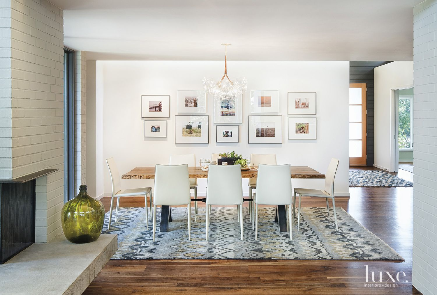 Contemporary White Dining Room with Graphic Patterned Rug