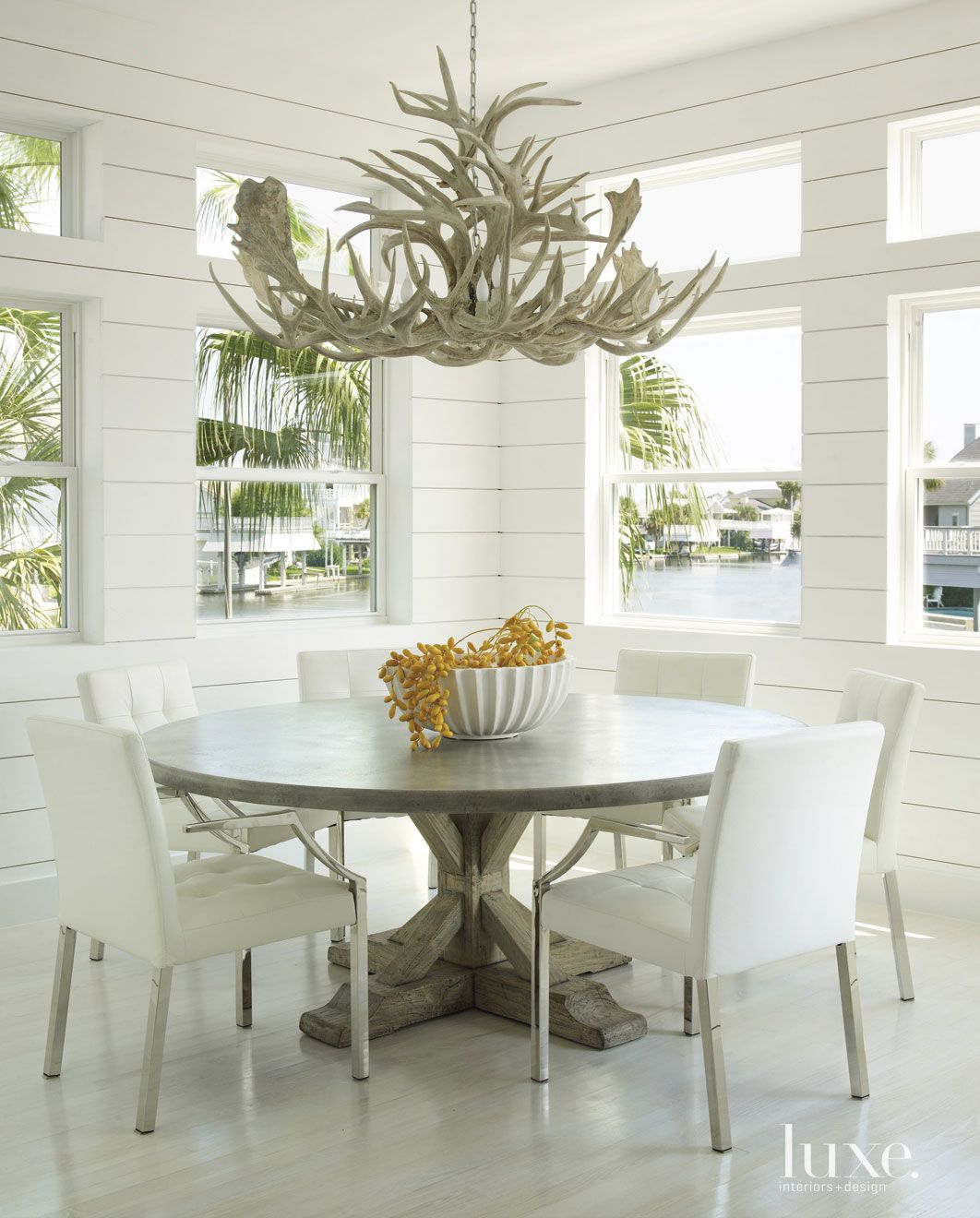 Contemporary White Dining Room with Shiplap Paneling