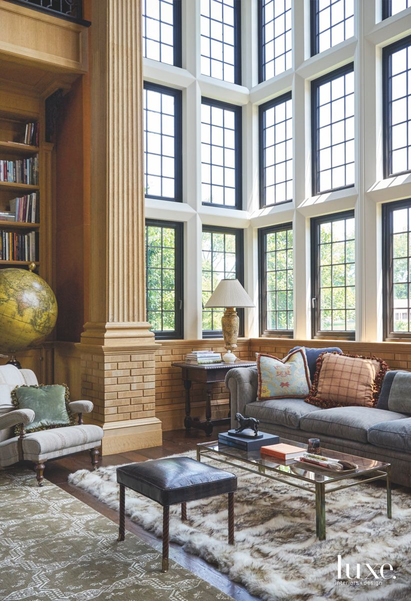 Floor to Ceiling Windows Corner Bench with Brick and Rugs