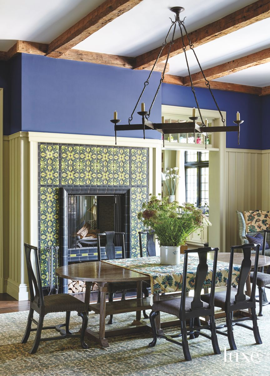 Tiled Blue Family Room with Iron Chandelier and Traditional Fireplace