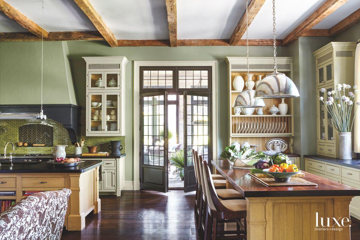 Green Traditional English Kitchen with Chevron Tile Backsplash and Seating